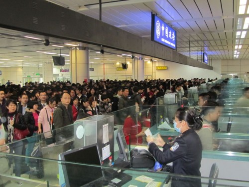 Travelers crossing from Hong Kong to Shenzhen at Shenzen Huanggang Border